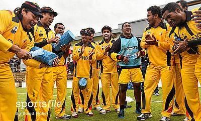 The Papua New Guinea players and support staff celebrating their 24-run victory over Jersey in Bready.