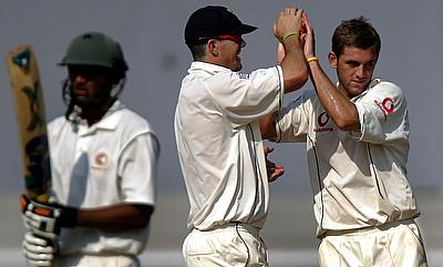 Hiken Shah (left) in action during a warm-up game between Board President's XI and the England team in 2006.