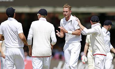 England celebrate a wicket at Lord's