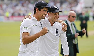 Alastair Cook and Joe Root celebrating England's win over Australia at Trent Bridge.