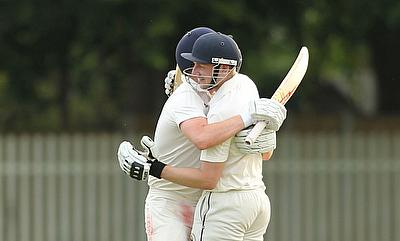 Ali Barrowman and Ben Watkins celebrate their match-winning partnership