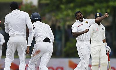 Rangana Herath celebrating the wicket of Harbhajan Singh on day four of the first Test in Galle.