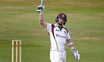 Steven Crook celebrating his century against Australia in the tour game in Northampton.