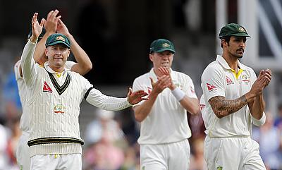 Australia's Michael Clarke waves goodbye at the end of the match with his teammates.