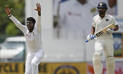 Tharindu Kaushal (left) celebrating the dismissal of Murali Vijay (right) on day two of the second Test in Colombo