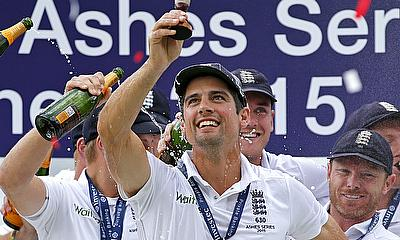 England's Alastair Cook and teammates celebrate winning the Ashes with the urn.