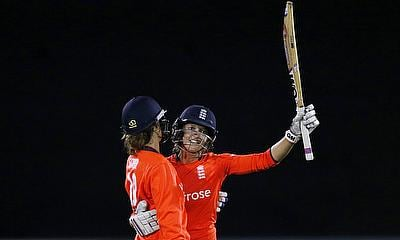 Sarah Taylor (right) celebrates reaching her half-century