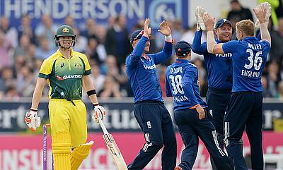 England team celebrating the wicket of Australian captain Steven Smith (left) at Headingley.