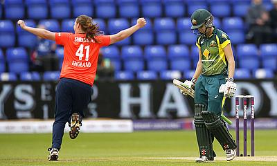 Anya Shrubsole celebrates taking the wicket of Jess Cameron