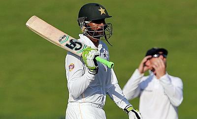 Shoaib Malik celebrating his century against England on day one of the first Test in Abu Dhabi.
