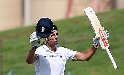 Alastair Cook celebrates reaching his century on day three of the first Test against Pakistan in Abu Dhabi