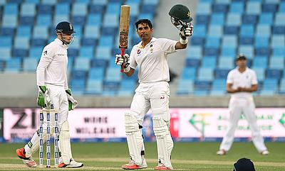 Misbah-ul-Haq celebrating his century against England on day one of the second Test in Dubai