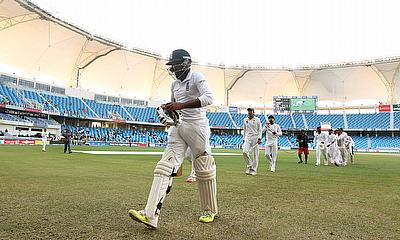 Adil Rashid leaves the field after so nearly guiding England to victory in Dubai