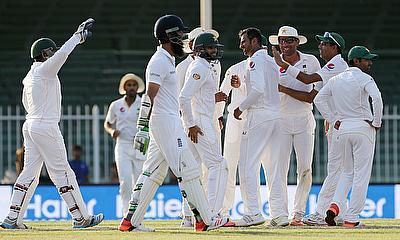 Pakistan celebrate the wicket of Moeen Ali on day four of the third Test in Sharjah.
