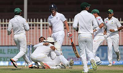 Pakistan celebrate the wicket of Alastair Cook on day five in Sharjah