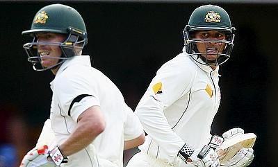 David Warner (left) and Usman Khawaja (right) shared a 150-run stand for the second wicket in the first Test against New Zealand in Brisbane.