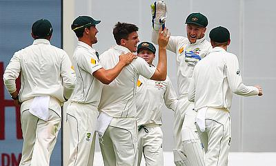 Australian players celebrating the wicket of Brendon McCullum on the final day of the Brisbane Test.