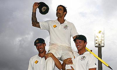 Mitchell Johnson (centre) is carried off the field by his teammates Mitchell Starc (left) and Josh Hazlewood (right) on the final day of the WACA Test