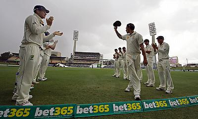 Mitchell Johnson given a guard of honour by his team mates on the fifth day at WACA.