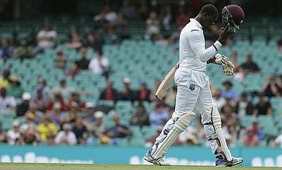 Carlos Brathwaite walks off after scoring 69 off 71 deliveries on day two of the third Test in Sydney.