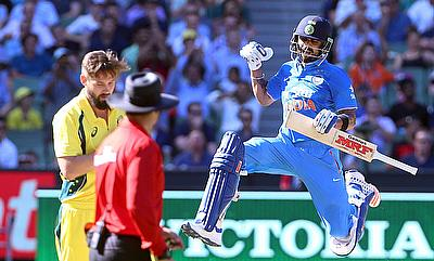 Kane Richardson (left) picked a five-wicket haul after Virat Kohli (right) scored his 25th ODI century.
