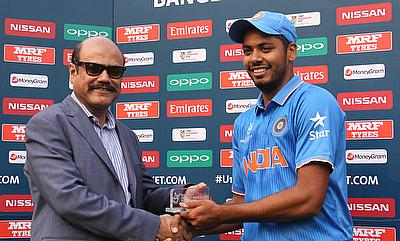 Anvesh Khan (right) being awarded the man of the match for his four-wicket haul.