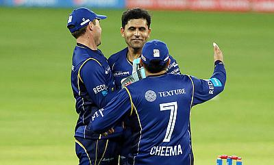 Capricorn Commanders celebrating the victory after a terrific final over from Abdul Razzaq (centre).