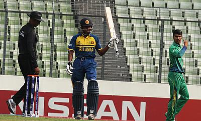 Kamindu Mendis (centre) celebrating his fifty.