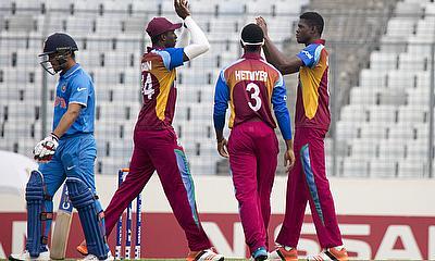 Alzarri Joseph (right) celebrating the wicket of Indian skipper Ishan Kishan (left).