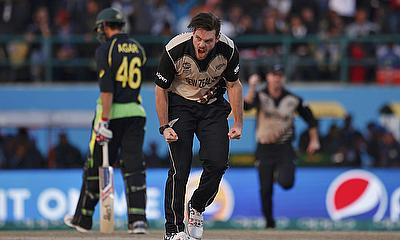 Mitchell McClenaghan celebrates taking the vital wicket of Mitchell Marsh