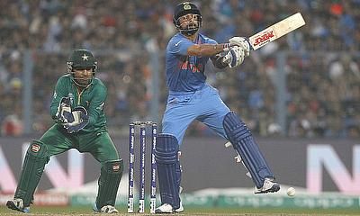 Virat Kohli plays a shot as Sarfaraz Ahmed looks on