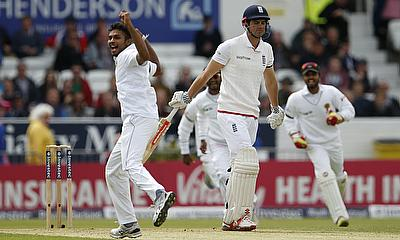 Dasun Shanaka (left) celebrating the wicket of Alastair Cook (centre) on day one of Headingley Test.