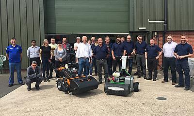 Andy Walker (centre, blue shirt) recently celebrated 40 years with SISIS