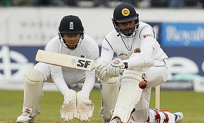 Dinesh Chandimal (right) scored a valiant 126 in the second innings to avoid innings defeat for Sri Lanka.