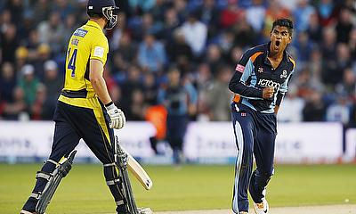 Azeem Rafiq (right) is back with Yorkshire