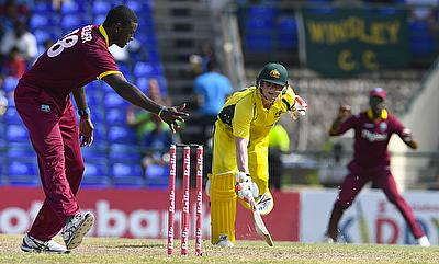 Steven Smith (centre) sustained the injury during his innings in St Kitts.