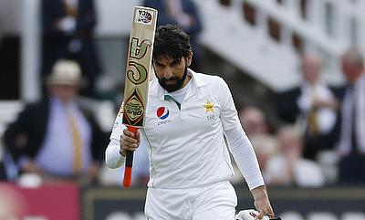 Misbah-ul-Haq celebrating his century on day one at Lord's.