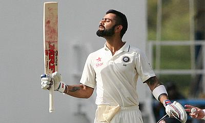 Virat Kohli celebrating his century on day one of the Antigua Test.