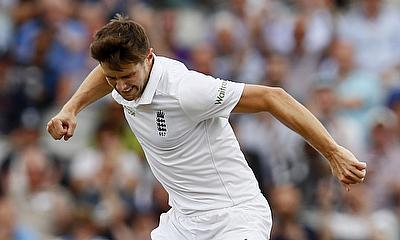 Chris Woakes celebrating the wicket of Yasir Shah on day three of the Old Trafford Test.
