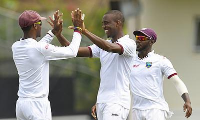 Miguel Cummins (centre) picked three wickets in the first innings.