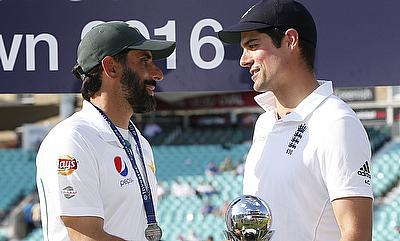 Both Misbah-ul-Haq (left) and Alastair Cook (right) sharing the trophy.