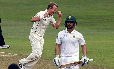 Neil Wagner (left) celebrating the wicket of JP Duminy (right) on day one of the first Test