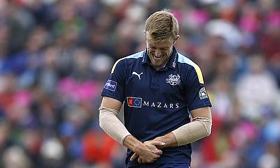 David Willey reacts with pain after he was hit in the hand.