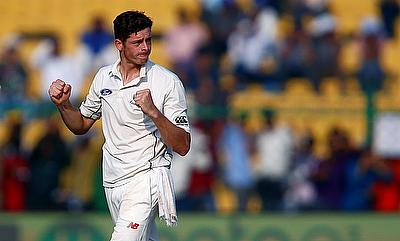 Mitchell Santner celebrating the wicket of Rohit Sharma on day one of the Kanpur Test