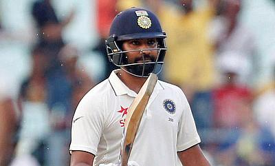 Rohit Sharma celebrating his fifty on day three of the Eden Garden Test.