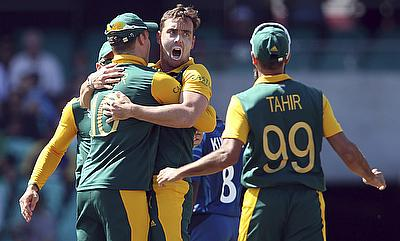 Kyle Abbott (centre) picked up four wickets to set Australia win