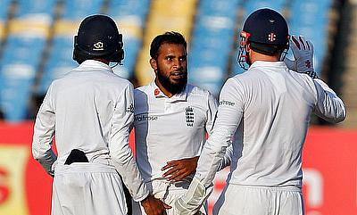Adil Rashid (centre) removed Murali Vijay in the penultimate over