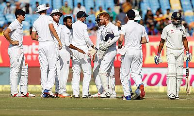 England players celebrating the wicket of Murali Vijay (right)
