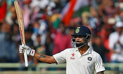Virat Kohli celebrating his century on the first day of the Vizag Test