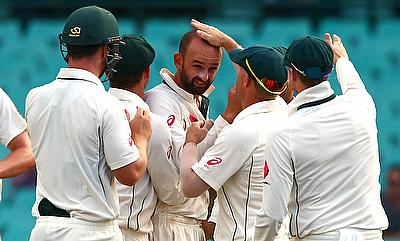 Nathan Lyon (centre) picked three wickets on day three